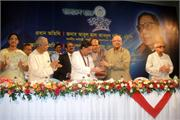 BB Governor hands cheque at the 13th Anniversary of Standard Bank Ltd. held in the city recently